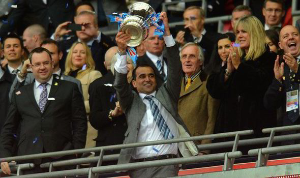 Martinez with the cup